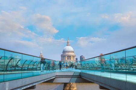 London, UK - May 23 2018: View of St Pauls Cathedral with people crossing the Millenium Bridge (London Millennium Footbridge)