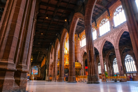 Manchester, UK - May 18 2018: Manchester Cathedral is the mother church of the Anglican Diocese of Manchester, seat of the Bishop of Manchester and the city's parish church
