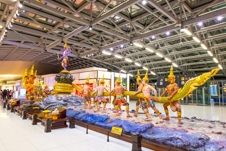 Bangkok, Thailand - April 19 2018: Scene of the Yaksha (demigod) Churning of the Milk Ocean sculpture at the duty free zone in Suvanabhumi Airport