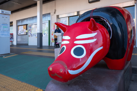 Aizuwakamatsu , Japan - April 21 2018:  Akabeko a legendary red cow which is normally refer to a toy cow which is a symbol of the Aizu region
