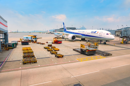Hong Kong - April 19 2018:  Jet flights dock in Hong Kong International Airport where it's the world's busiest cargo gateway and one of the world's busiest passenger airports Editorial