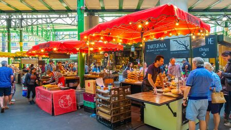 London, UK - May 23 2018: Unidentified people at Borough Market in Southwark, one of the largest and oldest food markets in London, today the market mainly sells speciality foods to the public Sajtókép