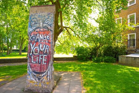 London, UK - May 22 2018: A part of Berlin wall taken from the remains nearby Brandenburg gate at Imperial War Museums (IWM), the wall is acquired by the museum in January, 1991