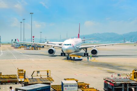 Hong Kong - April 19 2018: Jet flights dock in Hong Kong International Airport where it's the world's busiest cargo gateway and one of the world's busiest passenger airports