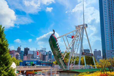 Tokyo, Japan - April 28 2018: Tokyo Dome City includes an amusement park and Tokyo Dome City Attractions occupies the former Korakuen Stadium and includes a roller coaster and a hubless Ferris wheel