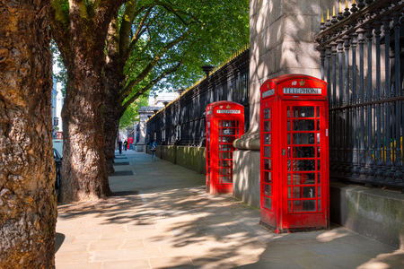 London, UK - May 20 2018: Traditional vintage red K6 telephone kiosk in front of the British Museum