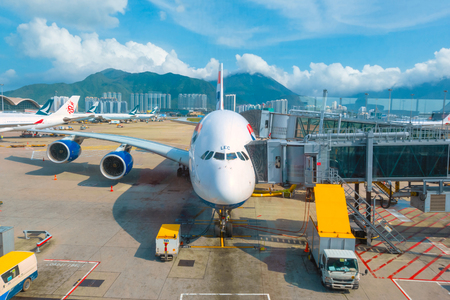Hong Kong - April 30 2018:  Jet flights dock in Hong Kong International Airport where its the worlds busiest cargo gateway and one of the worlds busiest passenger airports Sajtókép