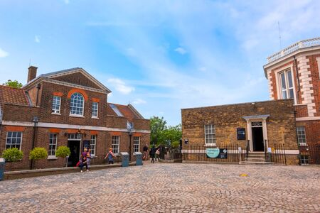 London, UK - May 21 2018: London, UK - May 14 2018: The Royal Observatory, Greenwich  is an observatory situated on a hill in Greenwich Park, best known for the fact that the prime meridian passes through