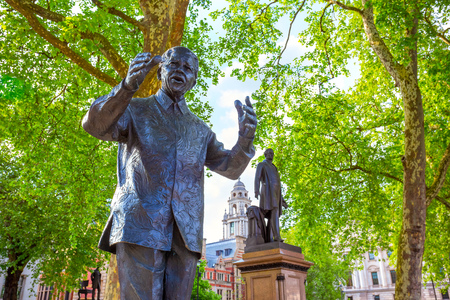 London, UK - May 13 2018: Statue of  Nelson Mandela at the Parliament Square with other twelve statues of statesmen and other notable individuals