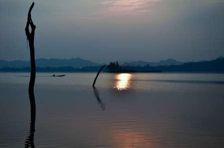 Boats, evening light, reservoir, Khao Laem National Park, Kanchanaburi, Thailand photo