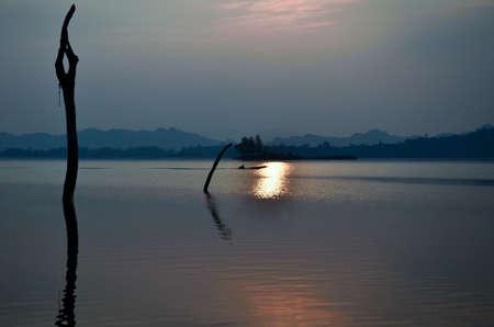Evening light, reservoir, Khao Laem National Park, Kanchanaburi, Thailand photo