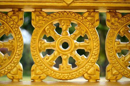 dharma wheel temple fence ,Thailand photo