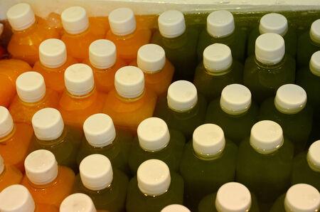 juice bottle: beautiful color of juice bottle at Thai market Stock Photo