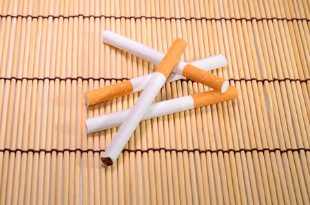mat: beautiful group of cigarettes set up on bamboo mat
