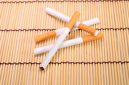 beautiful group of cigarettes set up on bamboo mat