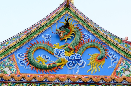 east end: The gabel end of an Asian designed building with a dragon statue