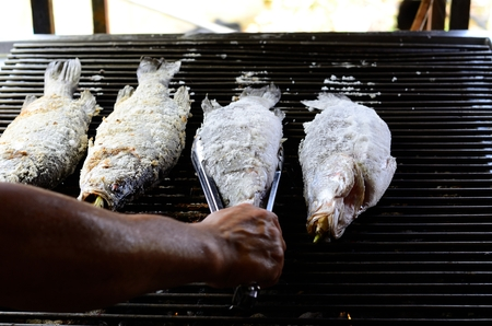 calcarifer: sailty grilled barramundi or Asian seabass (Lates calcarifer) at Thailand market Stock Photo
