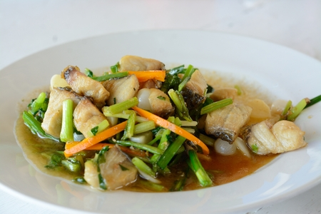 Delicious thai food ,Snapper fish fried celery in white dish