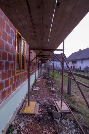 house with orange bricks from side without insulation