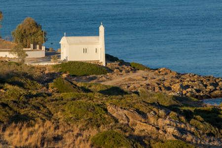 white church on shoreline on Samos island 免版税图像