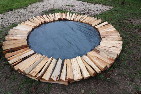 first layer of round wood pile