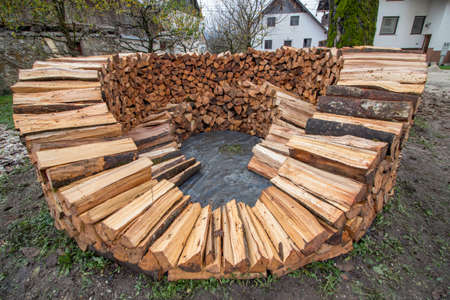 building inside layer of round wood pile