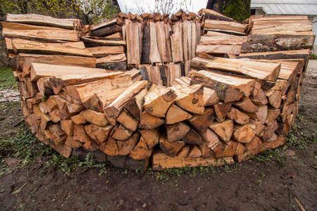 round wood pile in middle stage