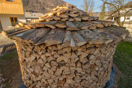 round wood pile with roof