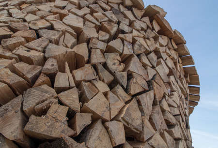 round wood pile from side