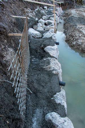 big rocks and concrete on river bank