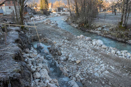 fixing up river bank in village