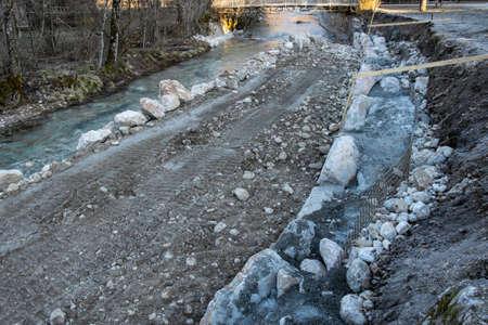 regulating river bank in village Imagens