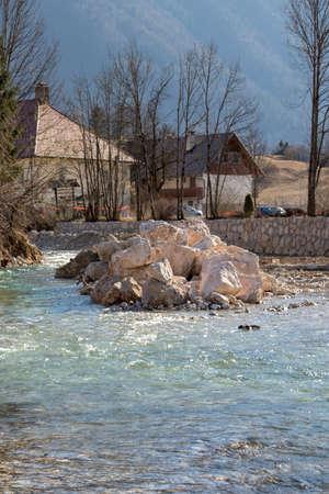 big pile of rocks in river