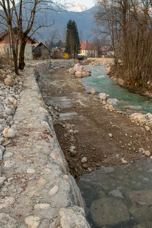 concrete riverbank in village