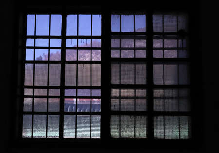old damaged window in warehouse Stock Photo