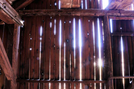 light shining through wooden planks