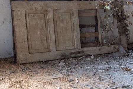 damaged door laying on floor Stock Photo