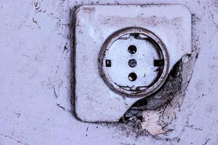 broken old socket on the wall