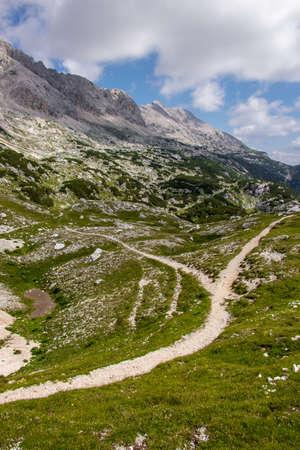 Mountain trail split in two paths, below Triglav