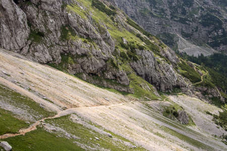 Mountain path through scree high in mountains Imagens