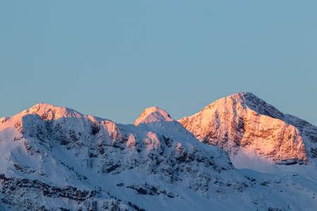 Sunlit snow capped mountain range, Bohinj