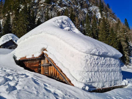 Mountain hut covered in snow Reklamní fotografie