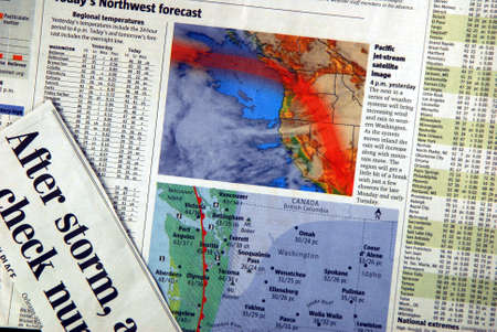 weather forecast in newspaper with clipping of storm