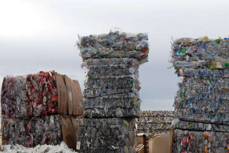 recycle center with bundles of plastic and cans Stock Photo