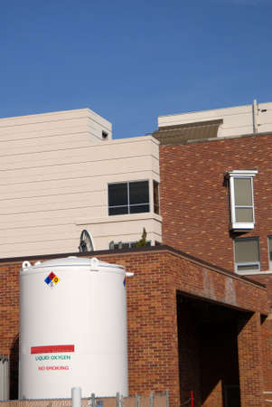 white liquid oxygen tank at brick hospital