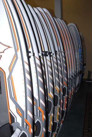 upright row: surf boards for sell in retail store