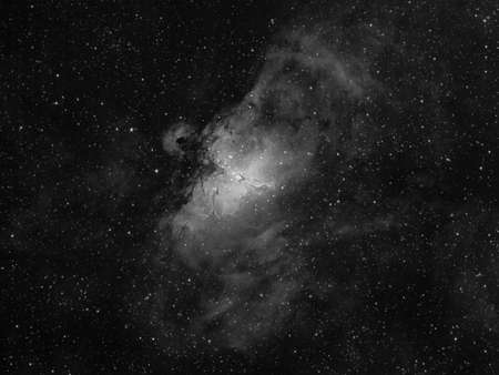 The Eagle Nebula catalogued as Messier 16 or M16, and as NGC 6611 is a young open cluster of stars in the constellation Serpens, Queen refer to visual impressions of the dark silhouette near the center of the nebula,an area made famous as the Pillars of