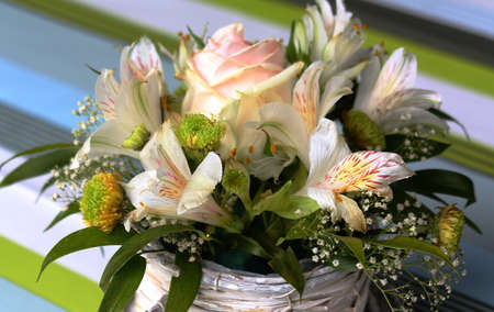 Beautiful bouquet of summer flowers in a birch pot. Ideal birthday gift.