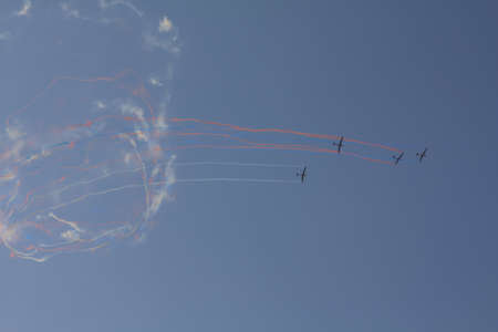Beautiful acrobatics show of a group of gliders in a sunny sky. Draw colorful loops in the sky. Banco de Imagens