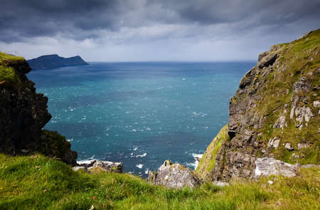 The landscape of the island RUNDE with the ocean in the background in Norway in the summer in cloudy weather Stock Photo